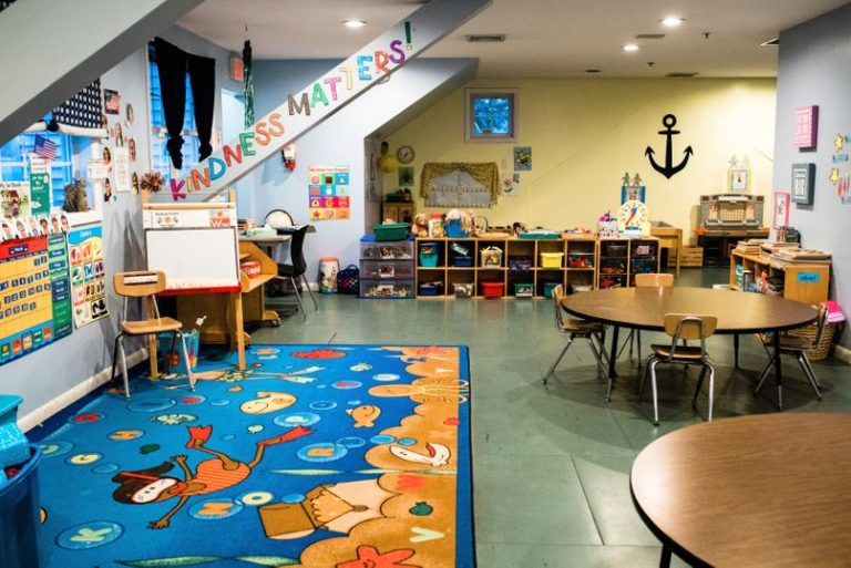 engaging design of nursery room with colorful and kid friendly floor mat and wall different angle designs at a Childcare Serving Branford, Cheshire, Wallingford, CT