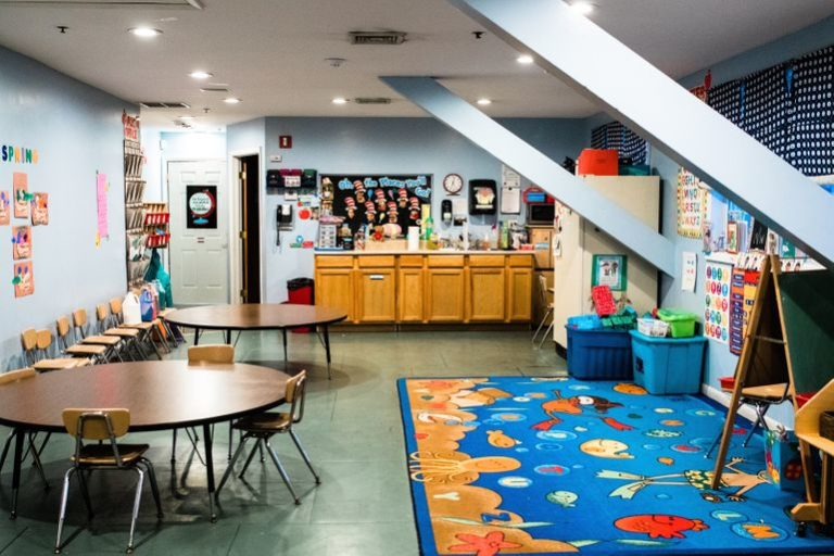 engaging design of nursery room with colorful and kid friendly floor mat and wall designs at a Childcare Serving Branford, Cheshire, Wallingford, CT