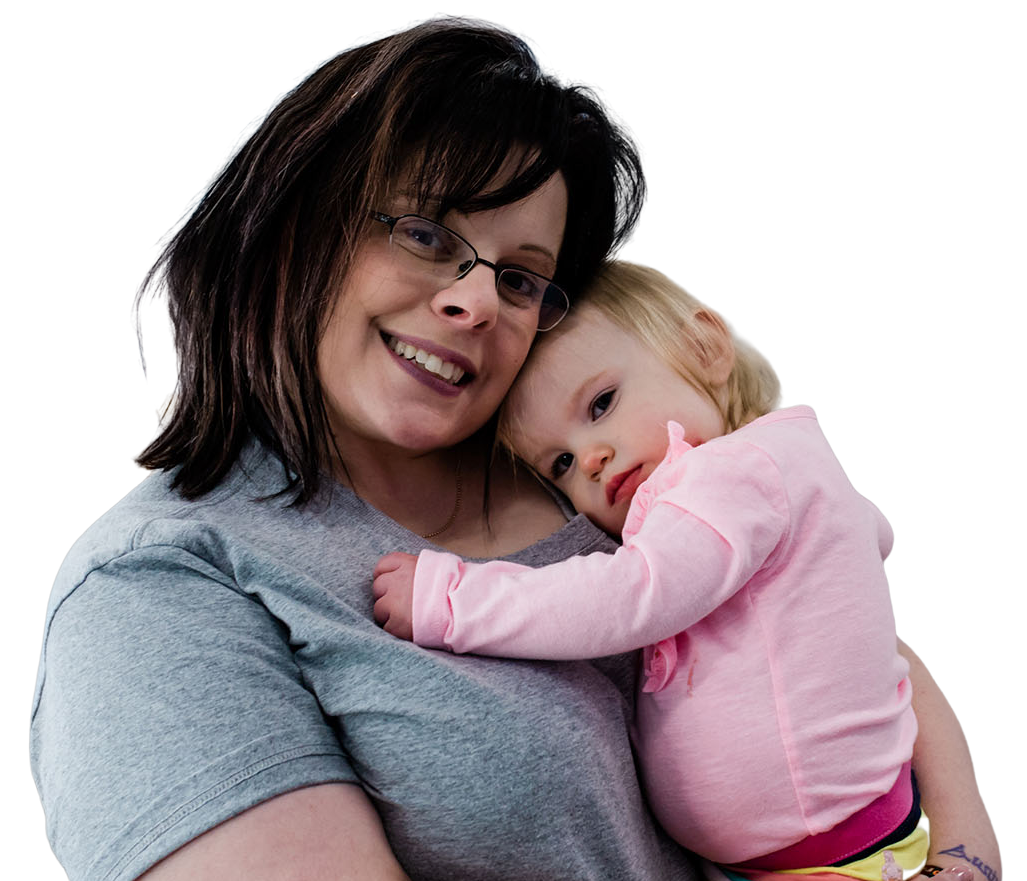 Happy mother hugging her adorable toddler girl at a Childcare Serving Branford, Cheshire, Wallingford, CT