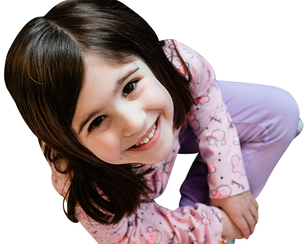 Cute little girl smiling wearing pink hello kitty jacket at a Childcare Serving Branford, Cheshire, Wallingford, CT